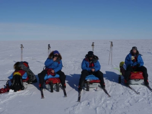 Three skiers having lunch at the Ross ice shelf.