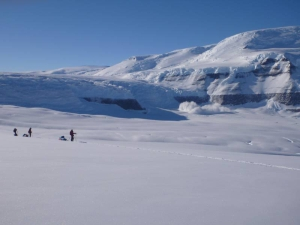 Skiers in a mountainous landscape in Antarctica.