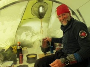 Vegard Ulvang preparing food in a tent