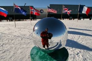 The globe at the South Pole, with the Amundsen-Scott station in the background
