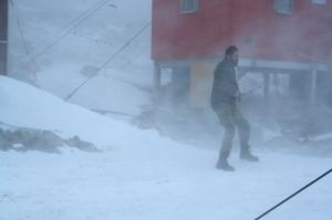 Jan-Gunnar Winther outside Troll station in strong storm conditions