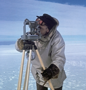 Surveyor with theodolite in Antarctica.